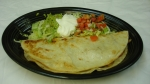Quesadilla Deluxe - Chicken or steak served with lettuce, sour cream, guacamole and pico de gallo.<br />